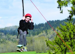 Cassidy soars down the universally accessible zipline.